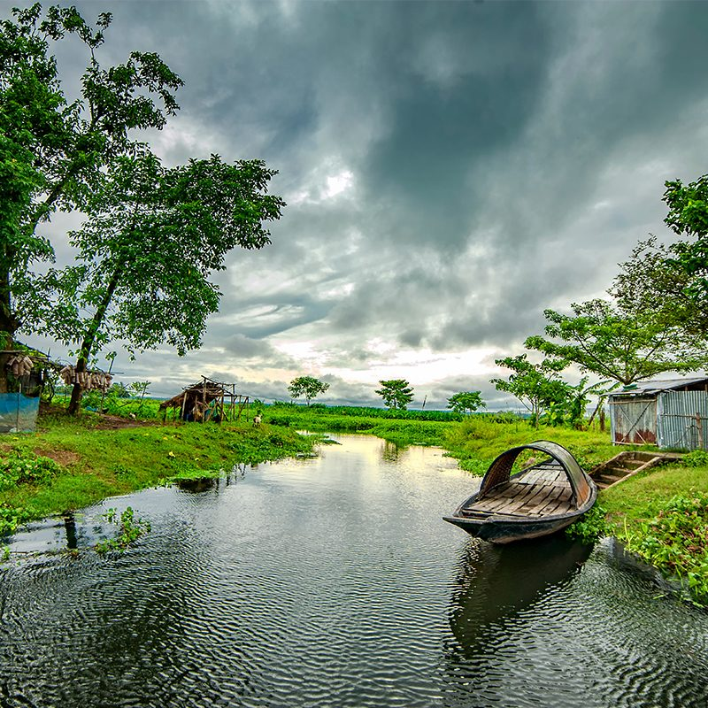 Boat on the banks of a river in Bangladesh.